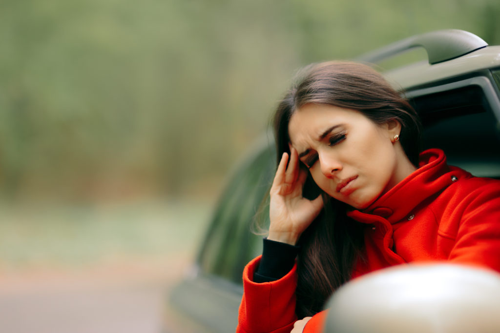 Woman with Motion Sickness With Car Window Rolled Down